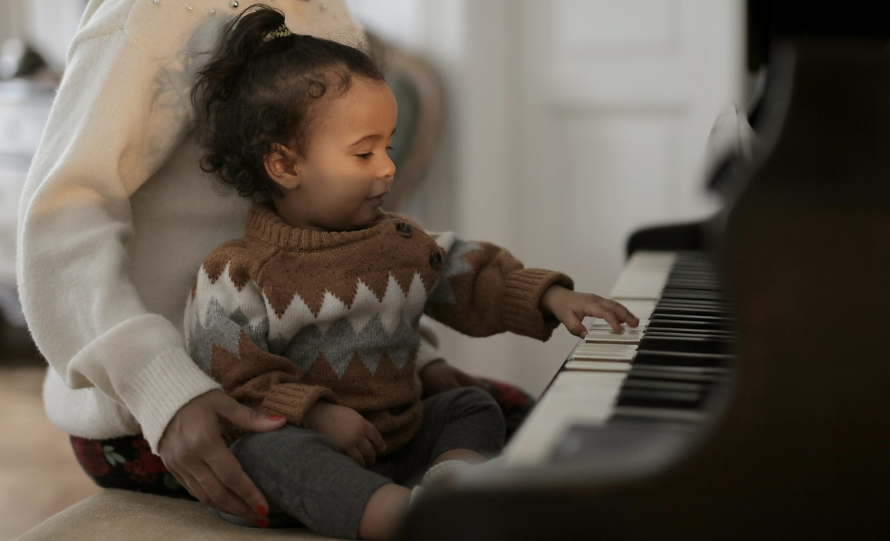 girl-in-brown-sweater-playing-piano-3820708