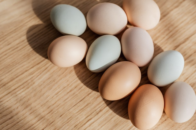 bunch-of-multicolored-eggs-on-wooden-table-4207652